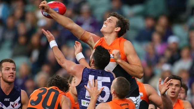 GWS captain Phil Davis punches clear against Port Adelaide.