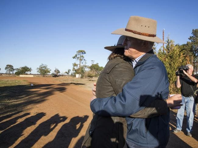 Prime Minister Malcolm Turnbull comforting charity worker Edwina Robertson in the town of Trangie, west of Dubbo, during his visit to drought stricken areas of regional NSW.