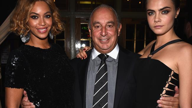 Beyoncé Knowles, with Sir Philip Green and Cara Delevingne at a Topshop in New York, later bought out Arcadia's share of her Ivy Park company. Picture: Dimitrios Kambouris/Getty