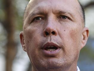 Australian Home Affairs Minister Peter Dutton speaks to the media after the  swearing-in ceremony