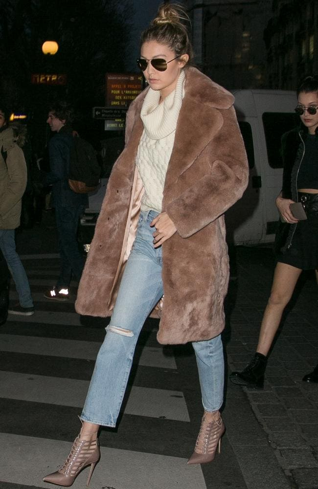 High-waisted and to the ankle, Gigi Hadid — pictured in Paris last month — is a fan of 'mom jeans'. Picture: Marc Piasecki/GC Images
