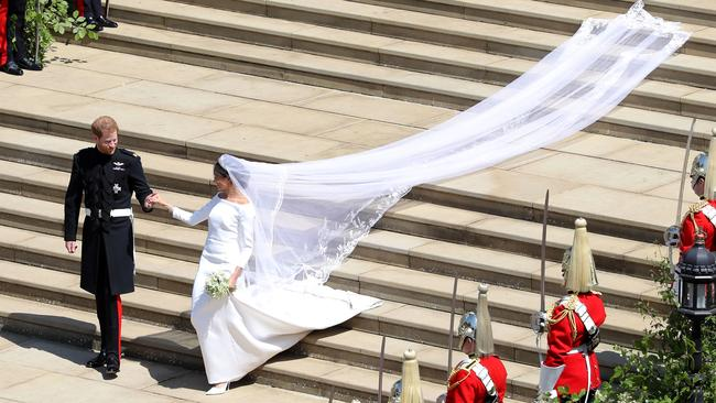 Prince Harry and his new wife Meghan, the Duchess of Sussex leave St George's Chapel just after their wedding. Picture: Andrew Matthews — WPA Pool/Getty