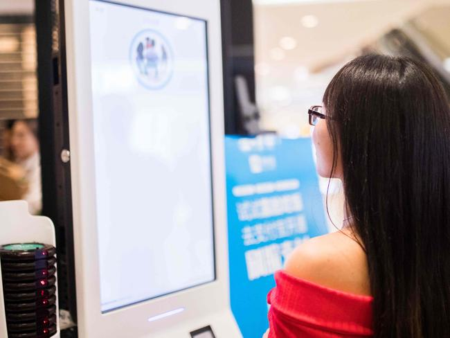 A Chinese customer experiences a facial recognition payment system. Picture: AFP