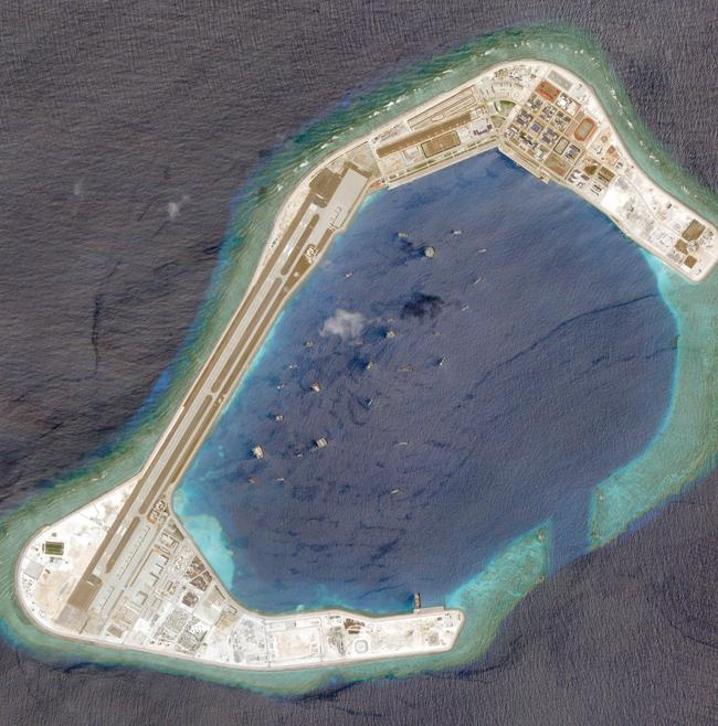 A atellite photo dated March 20, 2018, showing the artificial island fortress of Subi Reef - just 24km from the Philippine-occupied Thitu Island. Picture: Planet Labs Inc/Handout
