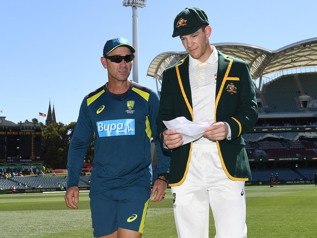 Australian coach Justin Langer walks from the field with captain Tim Paine after losing the toss on day one of the first Test match between Australia and India at the Adelaide Oval in Adelaide, Thursday, December 6, 2018. (AAP Image/Dave Hunt) NO ARCHIVING, EDITORIAL USE ONLY, IMAGES TO BE USED FOR NEWS REPORTING PURPOSES ONLY, NO COMMERCIAL USE WHATSOEVER, NO USE IN BOOKS WITHOUT PRIOR WRITTEN CONSENT FROM AAP