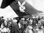 Playboy Enterprises founder and president Hugh Hefner gets a kiss from his girlfriend Barbara Benton under the tail of his 'Big Bunny' aircraft, 20/07/1970. Pic Keystone.