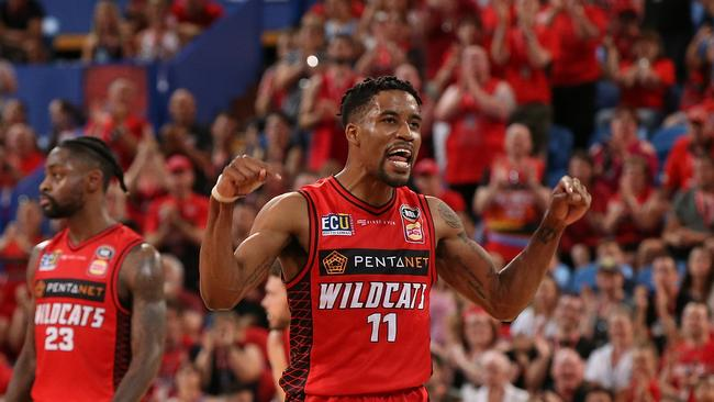 This is MY house! Bryce Cotton celebrates an overtime three-pointer. Picture: Getty