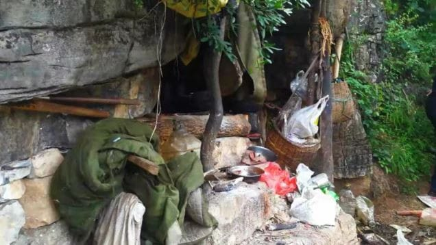 The cave was surrounded by pots and garbage. Picture: WeChat/Yongshan Police