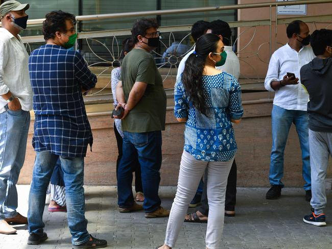 Bollywood director Tigmanshu Dhulia and other wellwishers wait outside hospital for Irrfan Khan in Mumbai on April 29, 2020. Picture: Indranil Mukherjee/AFP