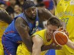 Australia's Mathew William Develladova is fouled by the Philippines' Andray Blache, center, during the FIBA World Cup Qualifiers Monday, July 2, 2018 at the Philippine Arena in suburban Bocaue township, Bulacan province north of Manila, Philippines. Australia defeated the Philippines 89-53 via default following a brawl in the third quarter. At left is Australia's Thon Marial Maker. (AP Photo/Bullit Marquez)