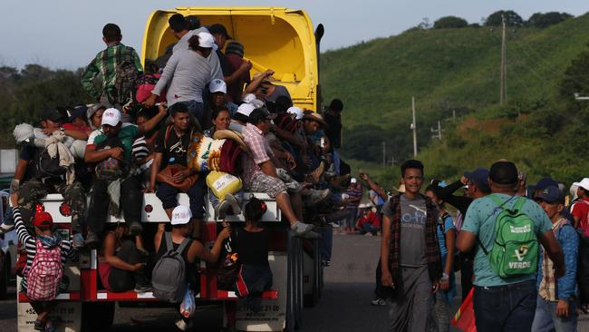 Migrants hitch rides on passing trucks, in Niltepec, southern Mexico, as the migrant caravan slowly advances towards Mexico City. Picture: Rebecca Blackwell/AP