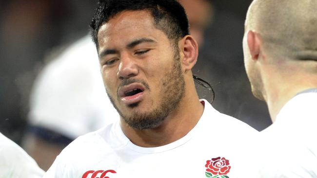 England's Manu Tuilagi stands on the ground after his team's loss to New Zealand in their second international rugby test match at Forsyth Barr Stadium in Dunedin, New Zealand, Saturday, June 14, 2014. (AP Photo/SNPA, Ross Setford) NEW ZEALAND OUT