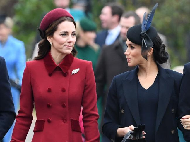 Britain's Catherine, Duchess of Cambridge talks to Meghan, Duchess of Sussex as they arrive for the Royal Family's traditional Christmas Day service at St Mary Magdalene Church. Picture: AFP