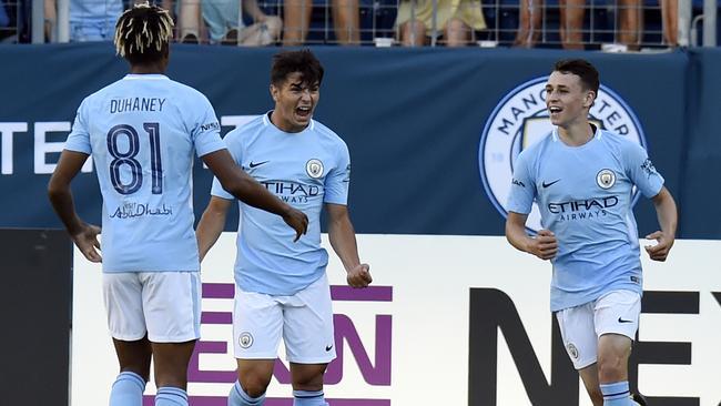Manchester City midfielder Brahim Diaz celebrates.