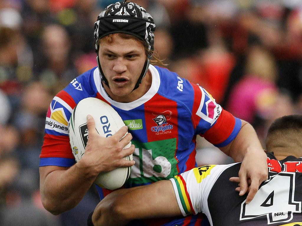 Kalyn Ponga of the Knights is tackled by Dean Whare during the Round 23 NRL match between the Penrith Panthers and the Newcastle Knights at Panthers Stadium in Sydney, Saturday, August 18, 2018. (AAP Image/Darren Pateman) NO ARCHIVING, EDITORIAL USE ONLY