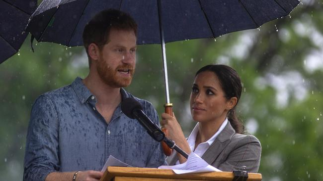 Prince Harry speaks at an event in Dubbo as his wife Meghan watches on. Picture: Ian Vogler/AP