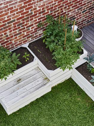 Planter boxes were factored into the ground-level garden design.