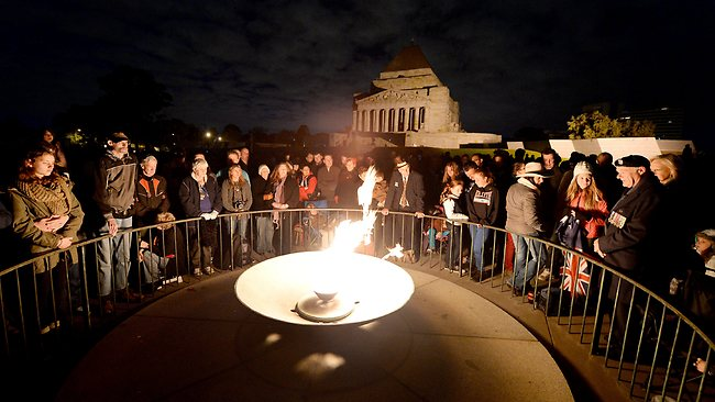 People gather around the eternal flame at the Shine of Remembrance for the dawn service. Picture: Garmston Nicole
