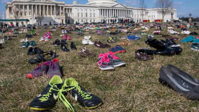 The lawn outside the US Capitol is covered with 7,000 pairs of empty shoes to memorialise the 7,000 children killed by gun violence since the Sandy Hook school shooting. AFP PHOTO / SAUL LOEB
