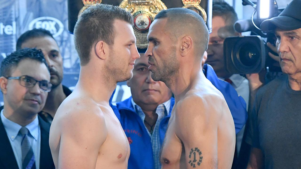 Boxers Jeff Horn (left) and Anthony Mundine (right) face off after their weigh ins at Suncorp Stadium in Brisbane. Picture: AAP