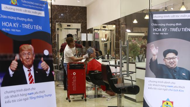 Barbers in Vietnam are offering up Trump and Kim specials for the summit. Picture: Hau Dinh/AP