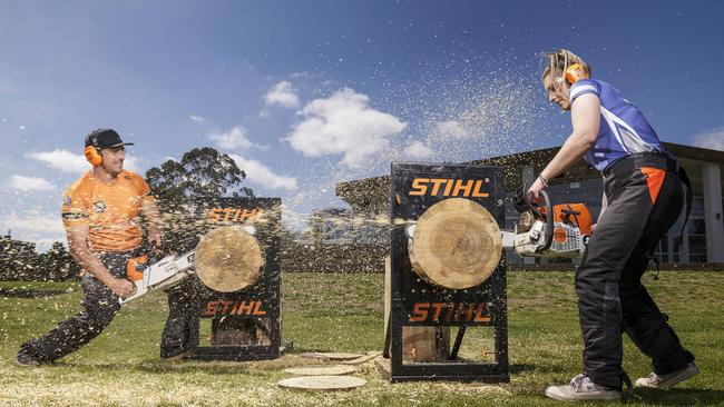 Brad DeLosa and Maddison Kirley demonstrate some chainsaw woodcutting. Picture: Daniel Pockett