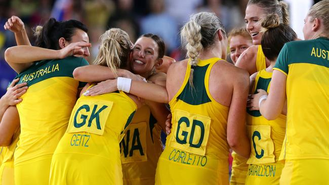 The Australian Diamonds celebrate their dominant win over New Zealand in the Commonwealth Games final.