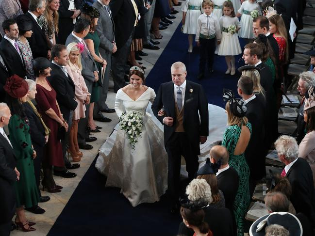 Britain's Princess Eugenie of York accompanied by Britain's Prince Andrew, Duke of York walks up the aisle during her wedding ceremony to Jack Brooksbank. Picture: AFP