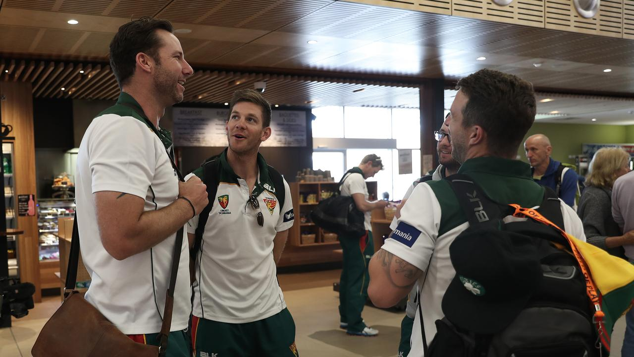 Tasmania's Tim Paine (centre) and Matthew Wade (right) speaking to Tigers' coach Adam Griffith (left) Picture: Luke Bowden