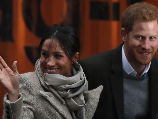 Britain's Prince Harry and his fiancee US actress Meghan Markle arrive for their visit to Reprezent 107.3FM community radio station in Brixton, south west London. Picture: AFP