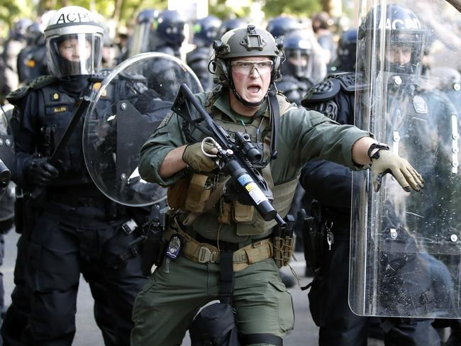 Police clash with protesters near the White House.