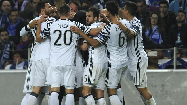 Juventus players celebrate after scoring their second goal against Porto.