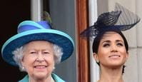 LONDON, ENGLAND - JULY 10: LONDON, ENGLAND - JULY 10:  Queen Elizabeth II and Meghan, Duchess of Sussex watch the RAF 100th anniversary flypast from the balcony of Buckingham Palace on July 10, 2018 in London, England. (Photo by Paul Grover - WPA Pool/Getty Images)