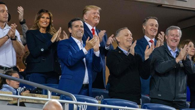 Donald Trump grinning as his image is flashed up on the big screen during game five of the World Series. Picture: Tasos Katopodis/AFP