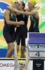 Australia's Emma McKeon, right, Brittany Elmslie, left, and Bronte Campbell, center, celebrate as Cate Campbell, bottom, finishes the women's 4x100-meter freestyle final setting a new world record during the swimming competitions at the 2016 Summer Olympics, Saturday, Aug. 6, 2016, in Rio de Janeiro, Brazil. (AP Photo/Michael Sohn)