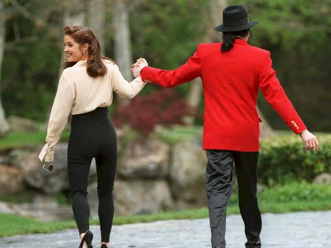 Lisa Marie Presley and then husband Michael Jackson go to greet children at his Neverland ranch in 1995. Picture: AFP PHOTO/Files