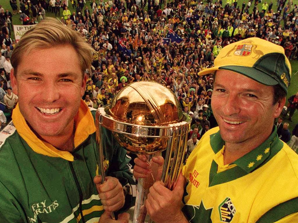 Cricketer Shane Warne (l) with Steve Waugh celebrating winning holding World Cup Trophy. Cricket - Australia vs Pakistan World Cup grand final match at Lords 20 Jun 1999.
