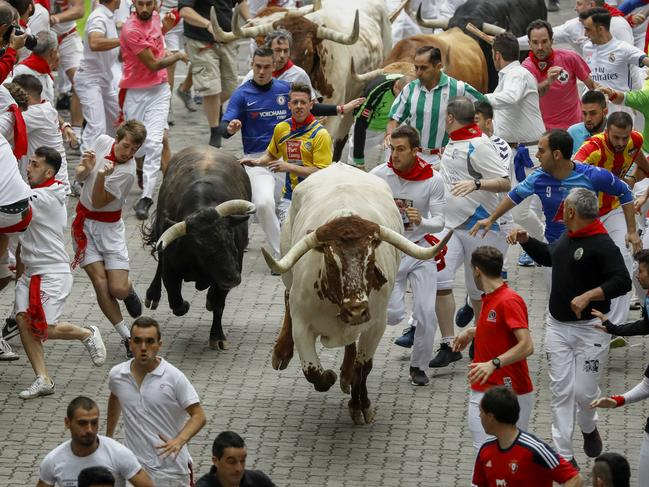 Fighting bulls storm through the streets of Pamplona. Picture: Getty