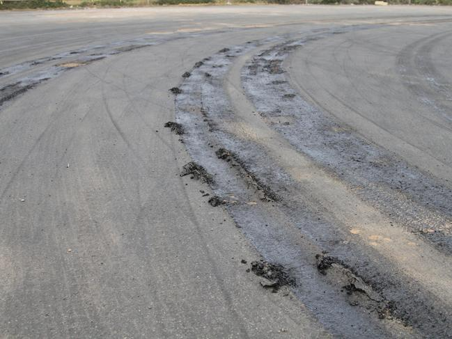 Truck tyres cut up a melted road in Ceduna on Thursday. Picture: Andrew Brooks