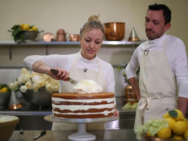 Claire Ptak and head baker, Izaak Adams work on the wedding cake. Picture: AFP