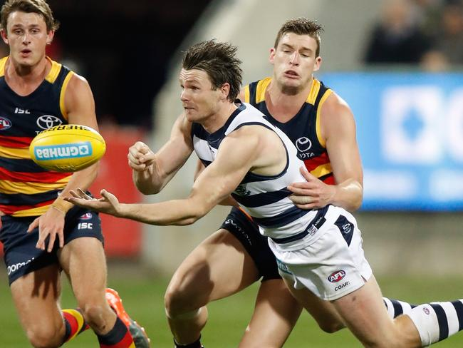 Patrick Dangerfield is tackled by Josh Jenkins. (Photo by Michael Willson/AFL Media/Getty Images)