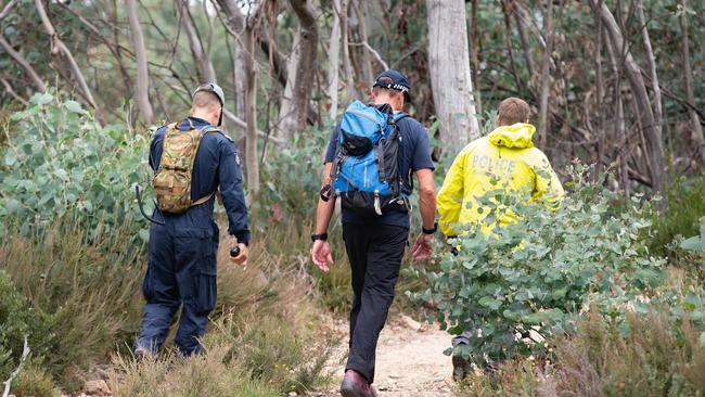 Police and SES crews scour rugged terrain in Mount Buffalo as they search for missing Melbourne couple, Trevor Salvado and Jacinta Bohan. Search and Rescue Police head off from the carpark the couples car was located in at the end of Reservoir Road. Picture: Sarah Matray