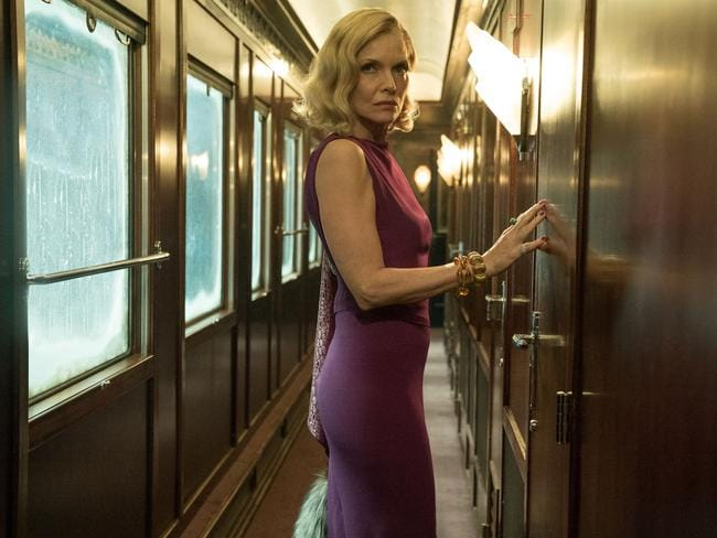 There's more to Michelle Pfeiffer's over-the-top style in Murder On The Orient Express than meets the eye.