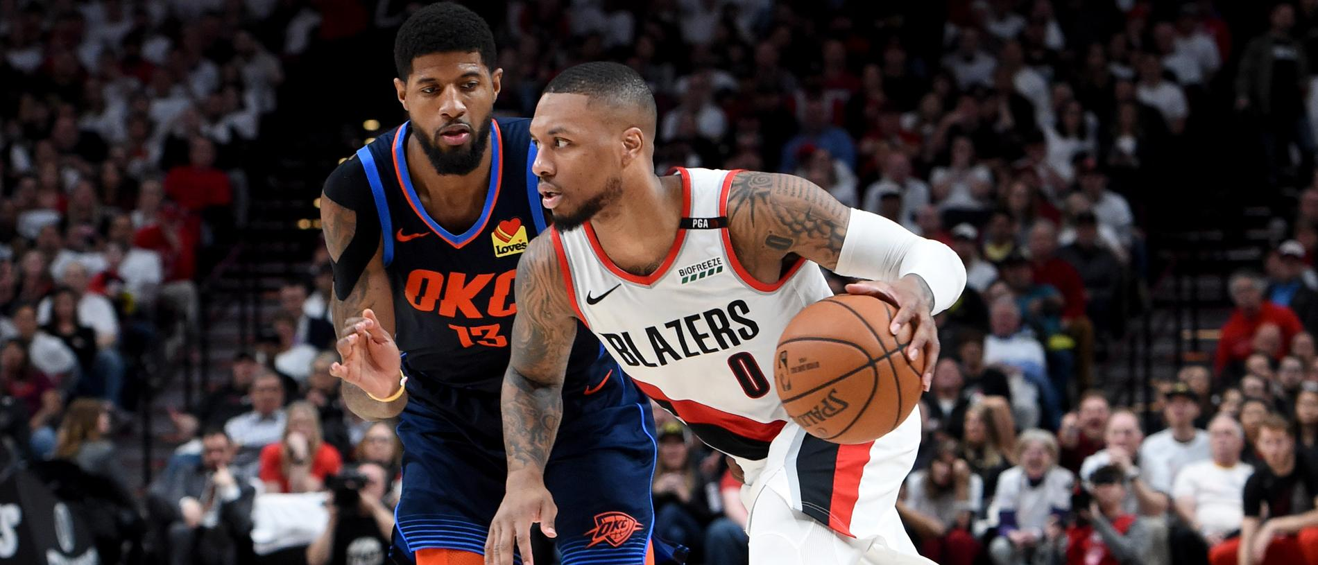 PORTLAND, OREGON - APRIL 23: Damian Lillard #0 of the Portland Trail Blazers drives to the basket on Paul George #13 of the Oklahoma City Thunder during the second half of Game Five of the Western Conference quarterfinals during the 2019 NBA Playoffs at Moda Center on April 23, 2019 in Portland, Oregon. The Blazers won 118-115. NOTE TO USER: User expressly acknowledges and agrees that, by downloading and or using this photograph, User is consenting to the terms and conditions of the Getty Images License Agreement. (Photo by Steve Dykes/Getty Images)