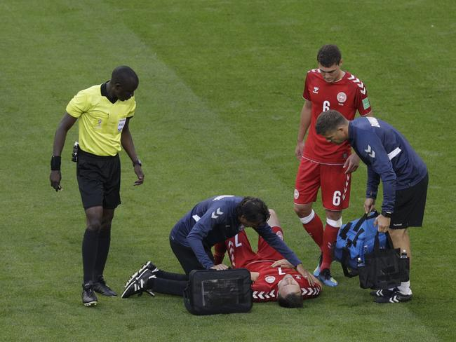 Denmark's William Kvist lies on the field after injuring during the group C match between Peru and Denmark (AP Photo/Gregorio Borgia)