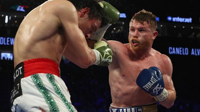 Canelo Alvarez (R) punches Julio Cesar Chavez Jr. during their May 2017 fight.