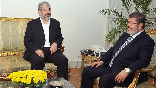 Gaza's Hamas Prime Minister Ismail Haniyeh, left, meets with Egyptian President Mohammed Morsi at the Presidential Palace in Cairo, Egypt. Picture: AP