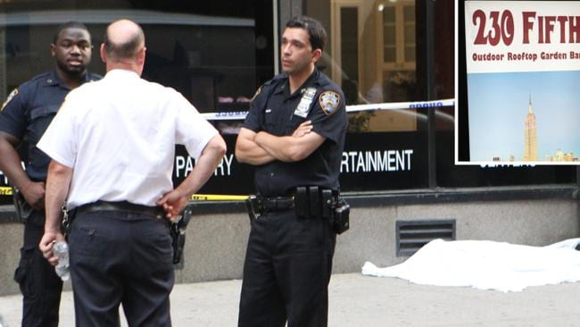 Police are the scene where a woman jumped 20 storeys to her death from swanky rooftop bar 230 Fifth in New York.