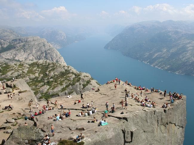 Preikestolen cliff is a famous tourist attraction in Norway.