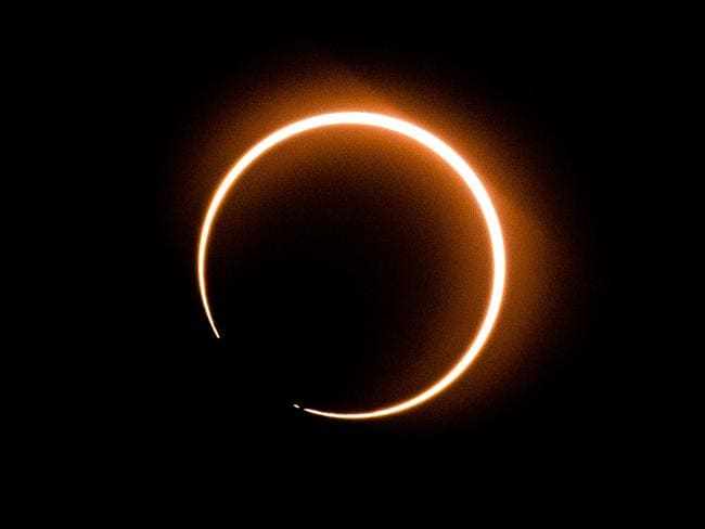 "The moon moves in front of the sun in a rare ""ring of fire"" solar eclipse as seen from Tanjung Piai, Malaysia. Picture: AFP"